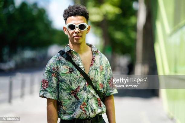 A guest wears a flower print shirt and sunglasses outside the Y3 show during Paris Fashion Week Menswear Spring/Summer 2018 on June 25 2017 in Paris...