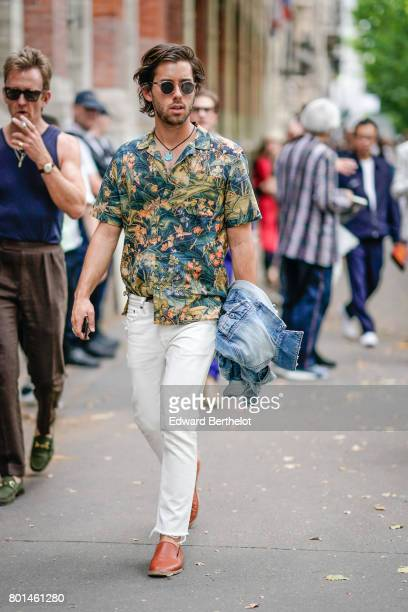 A guest wears a flower print shirt white pants brown shoesoutside the Paul Smith show during Paris Fashion Week Menswear Spring/Summer 2018 on June...