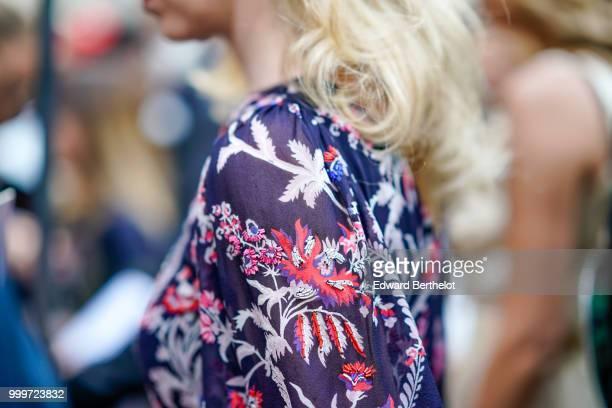 A guest wears a flower print top outside Dior during Paris Fashion Week Menswear SpringSummer 2019 on June 23 2018 in Paris France