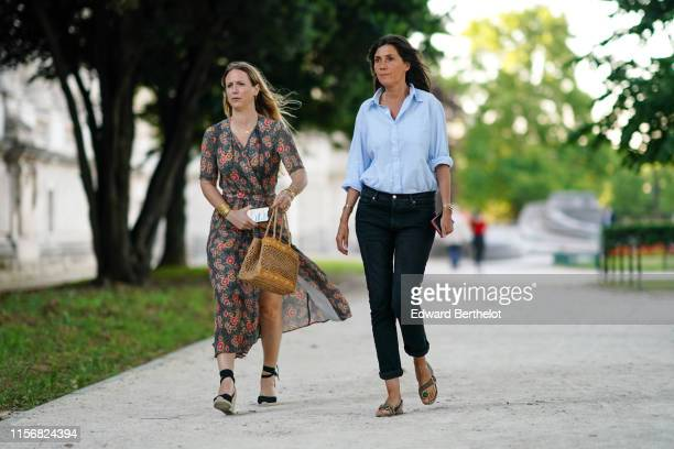 A guest wears a flowing floral print wrapover blue dress black ankle strap espadrilles a straw woven bag Emmanuelle Alt wears a light blue shirt...