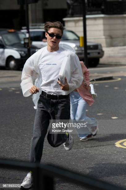 A guest wears a forever Colette T shirt and Nike trainers during London Fashion Week Men's on June 10 2018 in London England