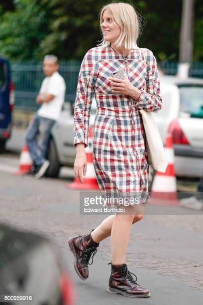 A guest wears a gingham vichy dress outside the Kenzo show during Paris Fashion Week Menswear Spring/Summer 2018 on June 25 2017 in Paris France