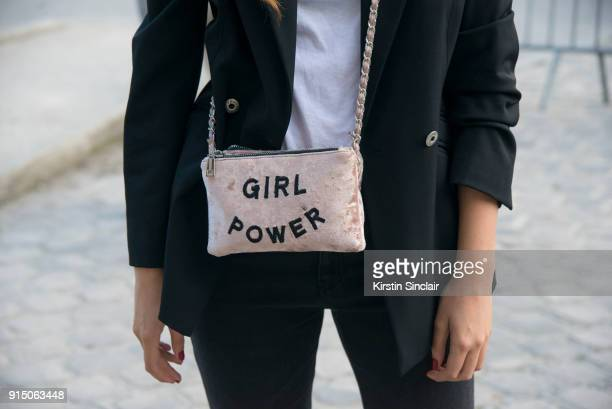 A guest wears a Girl Power bag day 5 of Paris Womens Fashion Week Spring/Summer 2018 on September 30 2017 in London England