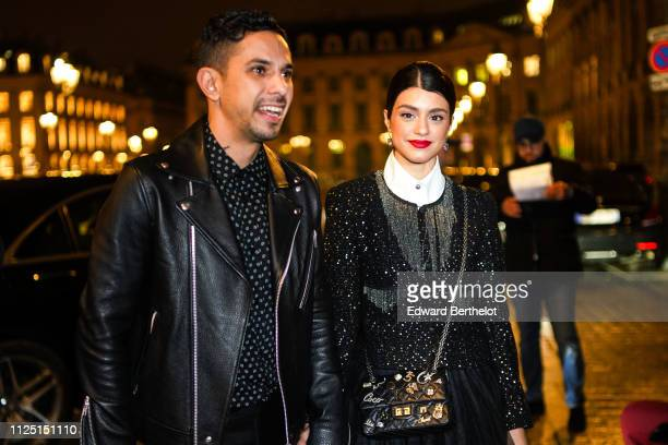 A guest wears a glitter black jacket a Chanel bag a black dress outside Armani during Paris Fashion Week Haute Couture Spring Summer 2020 on January...