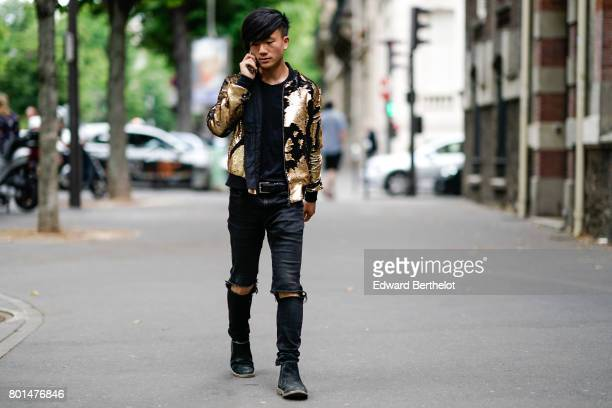 A guest wears a gold and black bomber jacket black ripped jeans outside the Paul Smith show during Paris Fashion Week Menswear Spring/Summer 2018 on...