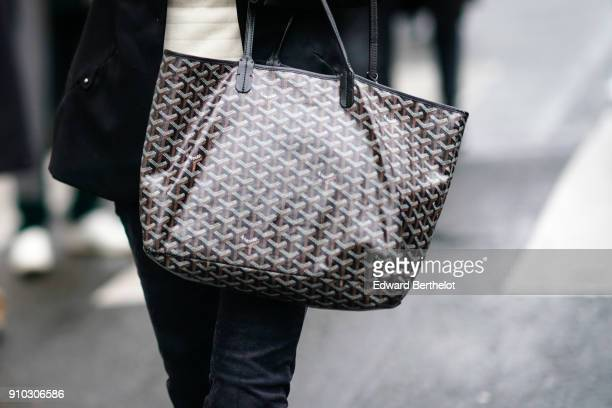 A guest wears a Goyard bag outside Maison Rabih Kayrouz during Paris Fashion Week Haute Couture Spring/Summer 2018 on January 25 2018 in Paris France