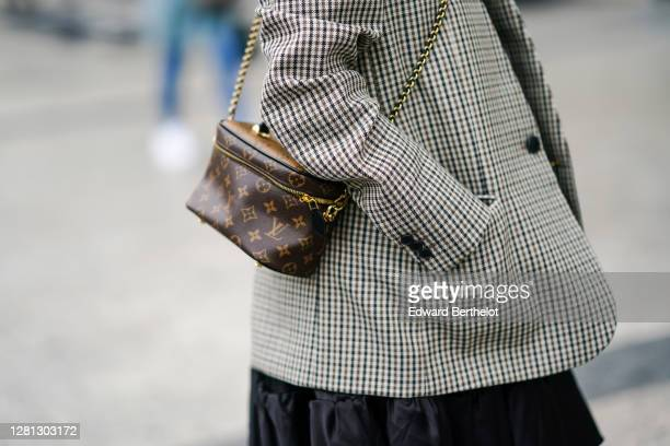 A guest wears a gray checked blazer jacket a brown leather Vuitton monogram bag outside Miu Miu during Paris Fashion Week Womenswear Spring Summer...