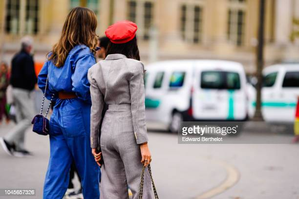 A guest wears a gray outfit and a red beret outside Chanel during Paris Fashion Week Womenswear Spring/Summer 2019 on October 2 2018 in Paris France