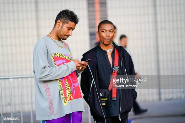 A guest wears a gray pull over with colored prints purple pants outside 1017 ALYX 9SM during Paris Fashion Week Menswear SpringSummer 2019 on June 24...