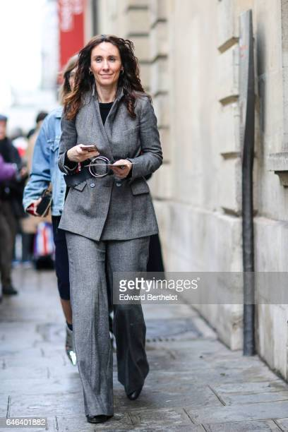 A guest wears a gray suit outside the JOUR/NE show during Paris Fashion Week Womenswear Fall/Winter 2017/2018 on February 28 2017 in Paris France