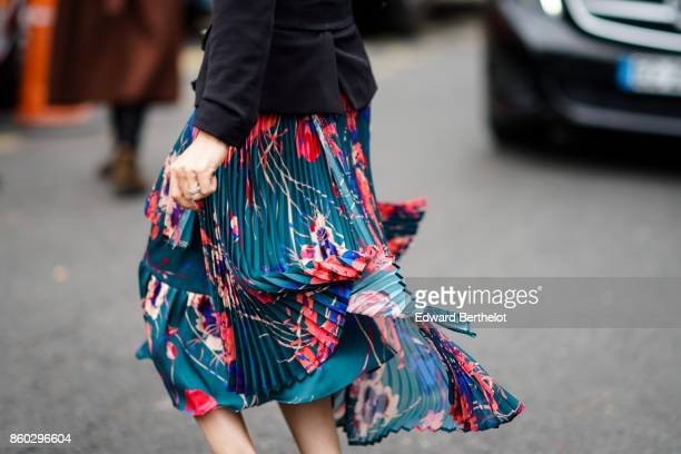 Guest wears a green, blue and rose floral print pleated skirt, outside Lanvin, during Paris Fashion Week Womenswear Spring/Summer 2018, on September...
