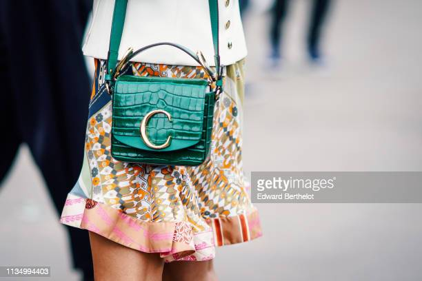 Guest wears a green crocodile leather Chloe bag, outside Chloe, during Paris Fashion Week Womenswear Fall/Winter 2019/2020, on February 28, 2019 in...