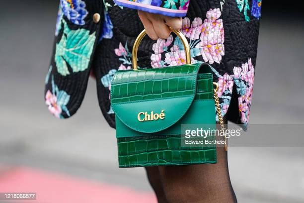 Guest wears a green crocodile pattern leather Chloe bag, outside Leonard, during Paris Fashion Week - Womenswear Fall/Winter 2020/2021, on February...