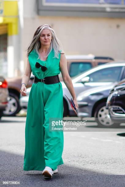 A guest wears a green dress a large black belt outside Wooyoungmi during Paris Fashion Week Menswear SpringSummer 2019 on June 23 2018 in Paris France