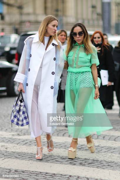 A guest wears a green dress outside the Chanel show during Paris Fashion Week Womenswear Fall/Winter 2017/2018 on March 7 2017 in Paris France