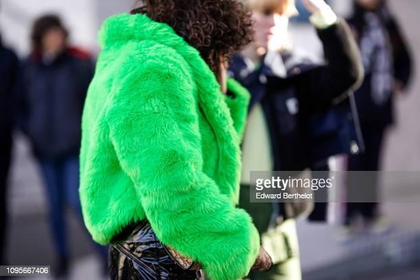 A guest wears a green faux fur jacket outside Rick Owens during Paris Fashion Week Menswear F/W 20192020 on January 17 2019 in Paris France