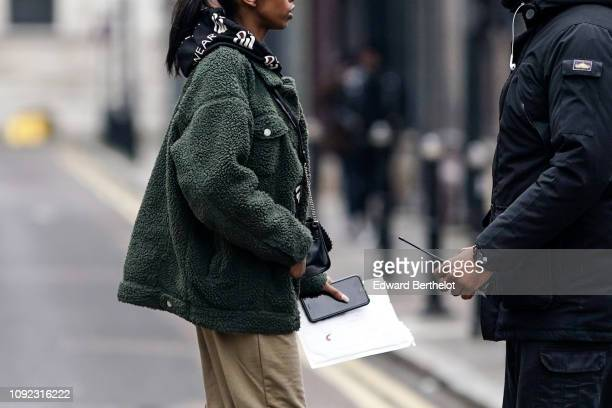 A guest wears a green fluffy jacket during London Fashion Week Men's January 2019 on January 05 2019 in London England