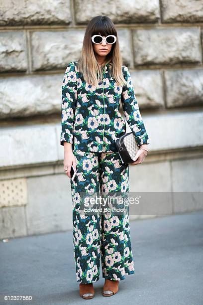 A guest wears a green full outfit with printed flowers outside of the Hermes show during Paris Fashion Week Spring Summer 2017 on October 3 2016 in...
