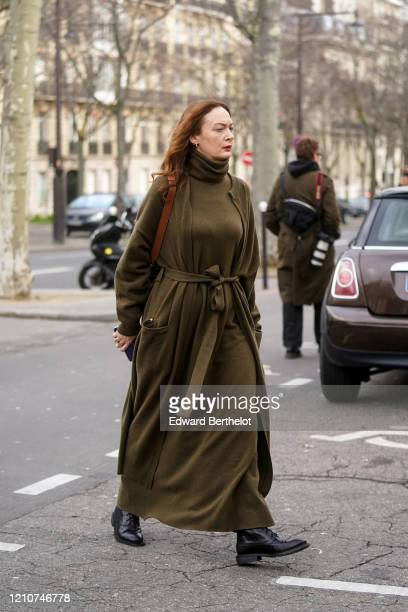 Guest wears a green khaki turtleneck wool dress and jacket, black leather pointy shoes, outside Gauchere, during Paris Fashion Week - Womenswear...