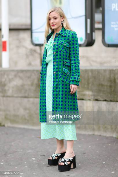 A guest wears a green long jacket a green dress and black shoes outside the Ellery show during Paris Fashion Week Womenswear Fall/Winter 2017/2018 on...
