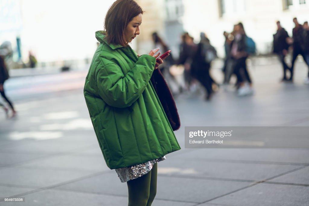8b3de4722ea9 A guest wears a green puffer jacket