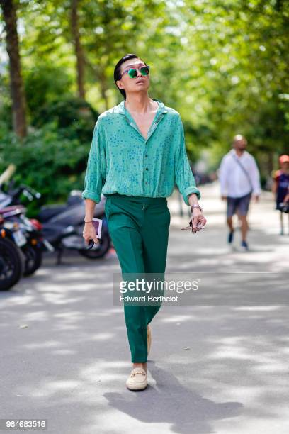 A guest wears a green shirt green pants outside Paul Smith during Paris Fashion Week Menswear SpringSummer 2019 on June 24 2018 in Paris France