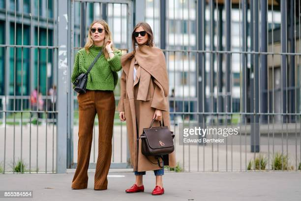 A guest wears a green top brown flare pants a guest wears a camel coat red shoes outside Carven during Paris Fashion Week Womenswear Spring/Summer...