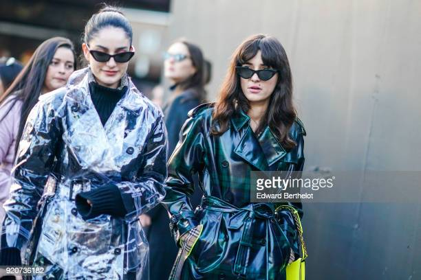 A guest wears a green trench coat during London Fashion Week February 2018 on February 17 2018 in London England