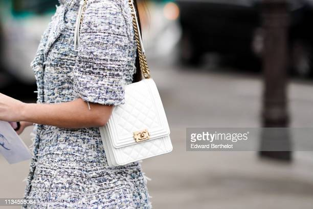 A guest wears a grey tweed short sleeves dress a white Chanel bag outside Chanel during Paris Fashion Week Womenswear Fall/Winter 2019/2020 on March...
