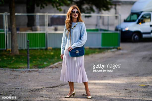 A guest wears a Gucci bag a pleated skirt outside Elie Saab during Paris Fashion Week Womenswear Spring/Summer 2018 on September 30 2017 in Paris...