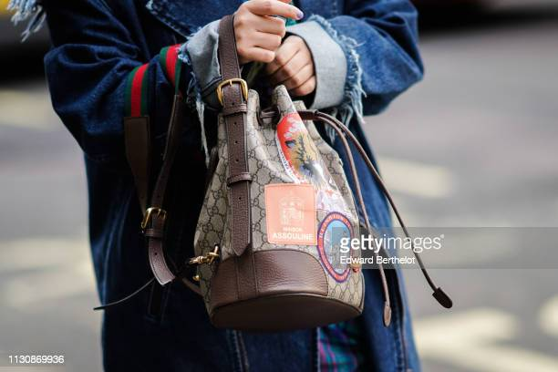 A guest wears a Gucci bag during London Fashion Week February 2019 on February 19 2019 in London England