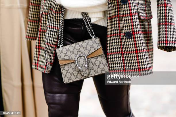 A guest wears a Gucci bag outside Beautiful People during Paris Fashion Week Womenswear Spring/Summer 2019 on October 2 2018 in Paris France