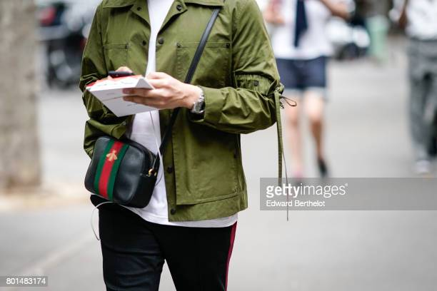 A guest wears a Gucci bag outside the Paul Smith show during Paris Fashion Week Menswear Spring/Summer 2018 on June 25 2017 in Paris France