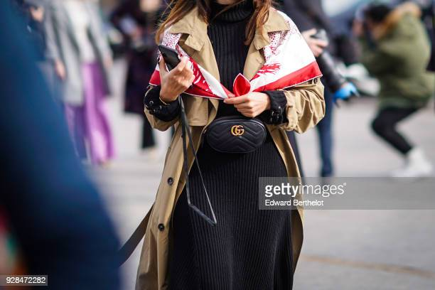 A guest wears a Gucci belt bag outside Chanel during Paris Fashion Week Womenswear Fall/Winter 2018/2019 on March 6 2018 in Paris France