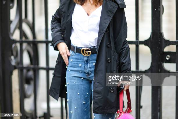 A guest wears a Gucci belt outside the Giambattista Valli show during Paris Fashion Week Womenswear Fall/Winter 2017/2018 on March 6 2017 in Paris...