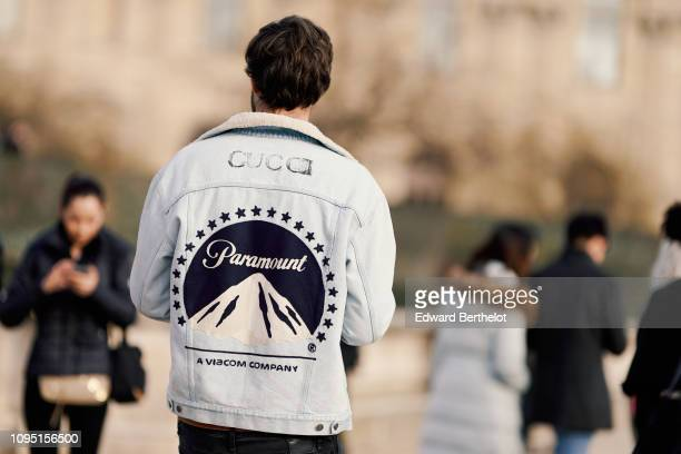 A guest wears a Gucci Paramount denim jacket outside OffWhite during Paris Fashion Week Menswear F/W 20192020 on January 16 2019 in Paris France