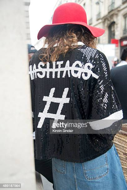 Guest wears a hashtag jacket on day 4 of Paris Fashion Week Haute Couture Autumn/Winter 2015 on July 8 2015 in Paris France