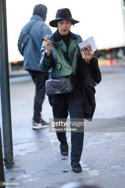 A guest wears a hat a green coat and a bag outside the Olivier Theyskens show during Paris Fashion Week Womenswear Fall/Winter 2017/2018 on February...