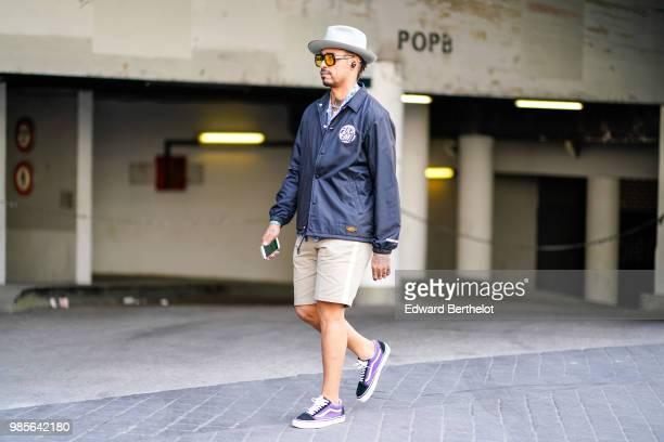 A guest wears a hat a jacket beige shorts sneakers outside 1017 ALYX 9SM during Paris Fashion Week Menswear SpringSummer 2019 on June 24 2018 in...
