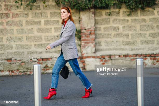 Guest wears a headband, a black and white houndstooth printed pattern blazer jacket, blue denim ripped jeans pants, red high heels leather pointy...