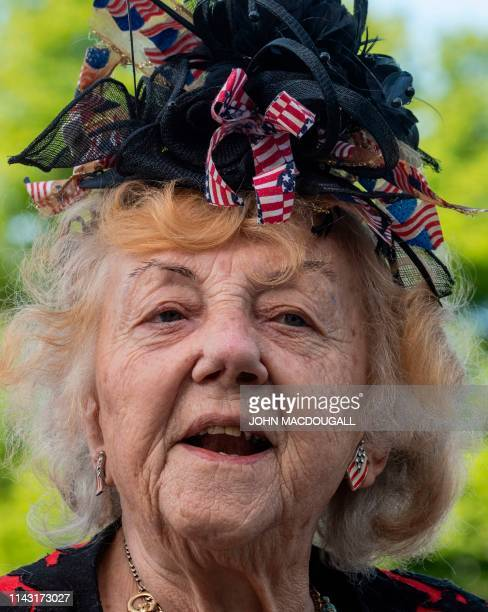 Guest wears a headpiece made up of small US flags as she attends a wreath-laying ceremony at the Berlin Airlift memorial outside Tempelhof airport in...