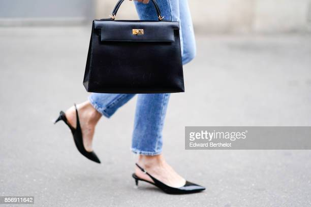 A guest wears a hermes bag outside Giambattista Valli during Paris Fashion Week Womenswear Spring/Summer 2018 on October 2 2017 in Paris France