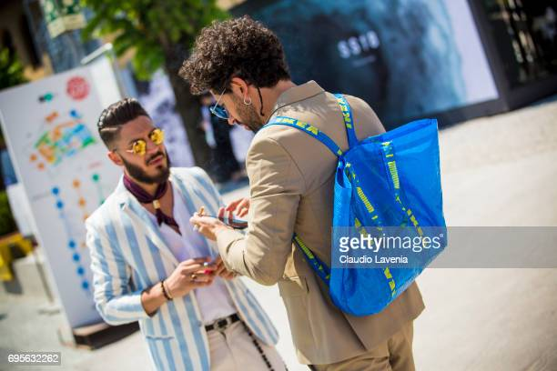 Guest wears a Ikea backpack during Pitti Immagine Uomo 92 at Fortezza Da Basso on June 13 2017 in Florence Italy