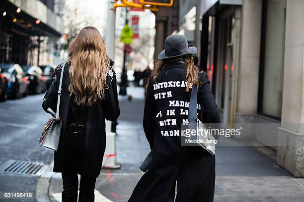 A guest wears a Intoxicated with madness I'm in love with my sadness Sylvia Plath / Smashing Pumpkins text jacket outside the Valentino PreFall 2017...
