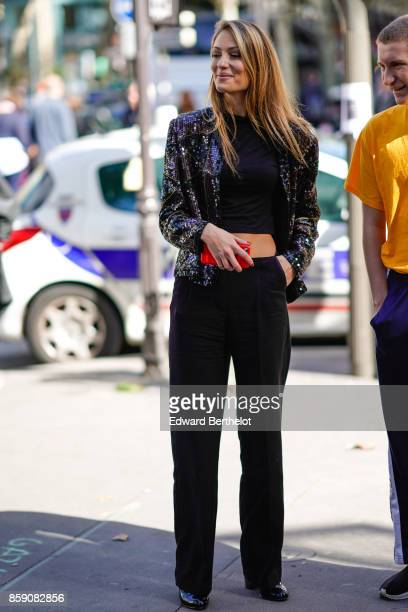A guest wears a jacket black flare pants outside Acne Studios during Paris Fashion Week Womenswear Spring/Summer 2018 on September 30 2017 in Paris...