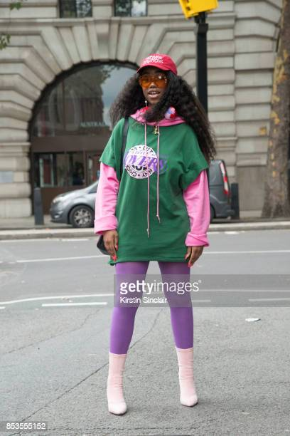 A guest wears a Kenzo bag on day 1 of London Womens Fashion Week Spring/Summer 2018 on September 15 2017 in London England