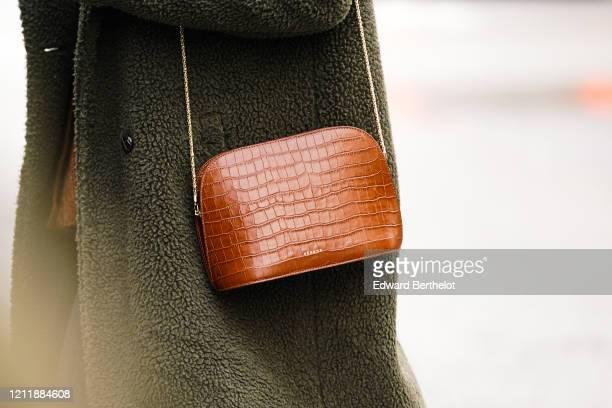 Guest wears a khaki fluffy faux-fur coat, a brown crocodile pattern Sezane bag, outside Giambattista Valli, during Paris Fashion Week - Womenswear...