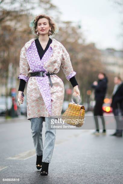A guest wears a kimono outside the Rochas show during Paris Fashion Week Womenswear Fall/Winter 2017/2018 on March 1 2017 in Paris France