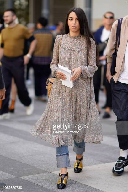 A guest wears a lace pleated dress Gucci shoes outside Issey Miyake during Paris Fashion Week Menswear SpringSummer 2019 on June 21 2018 in Paris...
