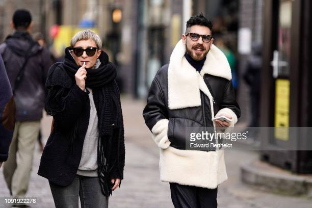 A guest wears a leather aviator jacket with inner lining sheep wool during London Fashion Week Men's January 2019 on January 06 2019 in London England
